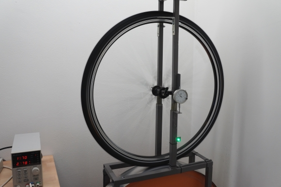 rolling resistance test machine with a road bike tire mounted