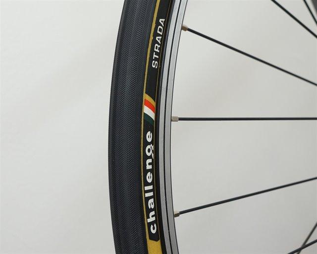 Challenge Strada Pro road bike tire on a rolling resistance test machine