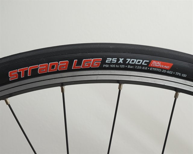 Clement Strada LGG road bike tire on a rolling resistance test machine