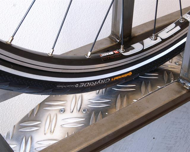 Continental City Ride II road bike tire on a rolling resistance test machine