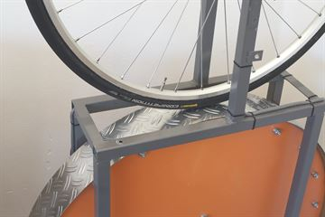 picture of a Continental Competition (tubular) on a rolling resistance test machine