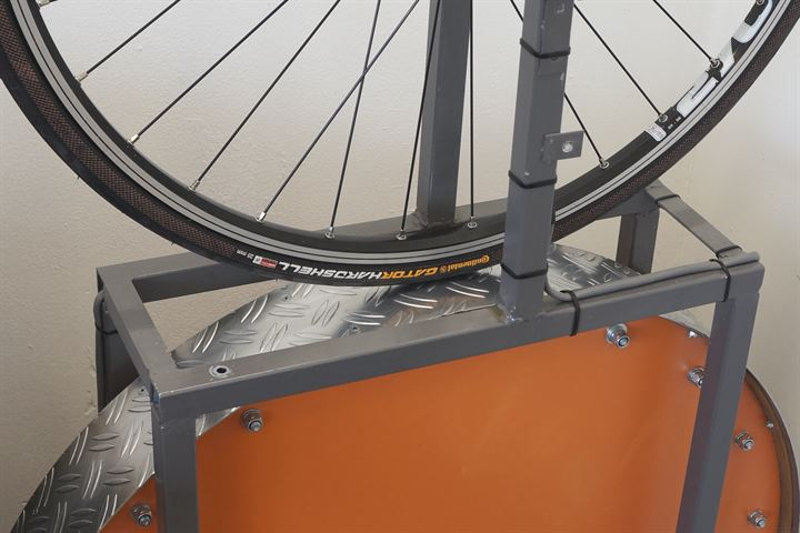Continental Gator Hardshell road bike tire on a rolling resistance test machine
