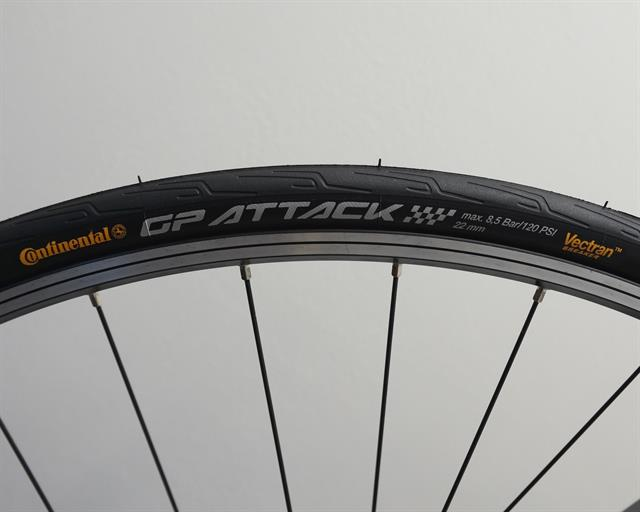 Continental Grand Prix Attack II road bike tire on a rolling resistance test machine