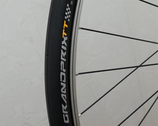 Continental Grand Prix TT road bike tire on a rolling resistance test machine