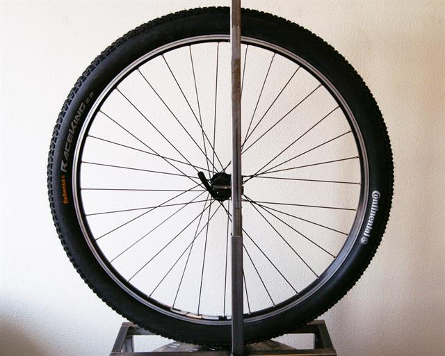 Continental Race King Sport  mountain bike tire on a rolling resistance test machine