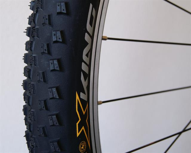 Continental X-King RaceSport  mountain bike tire on a rolling resistance test machine