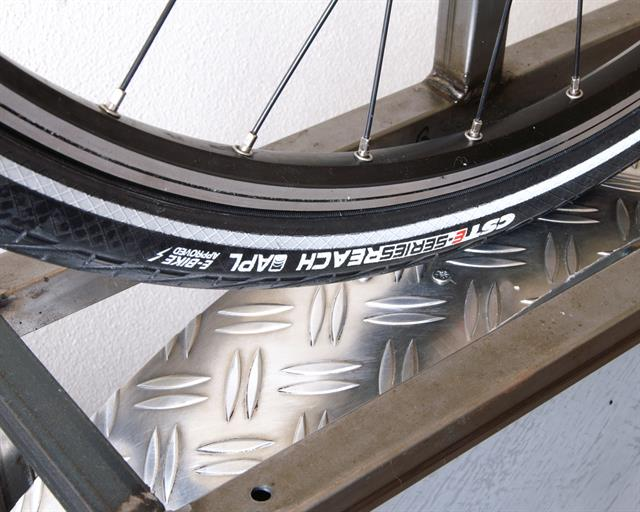 CST E-Series Reach Touring/E-Bike tire on a rolling resistance test machine