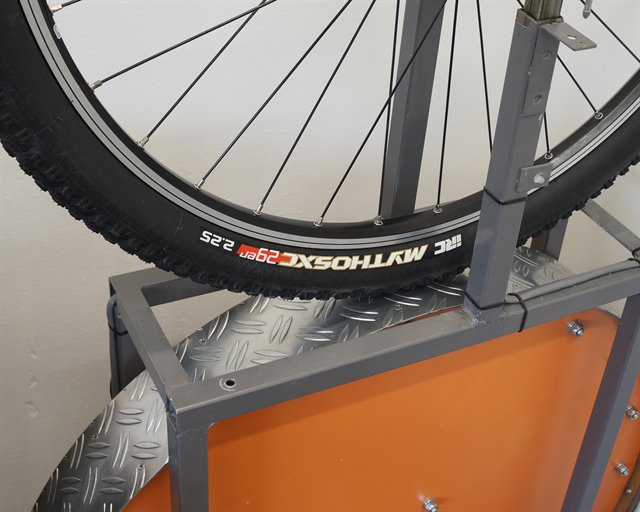IRC Mythos XC mountain bike tire on a rolling resistance test machine