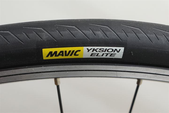 Mavic Yksion Elite road bike tire on a rolling resistance test machine