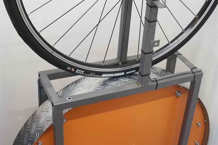 Maxxis High Road road bike tire on a rolling resistance test machine