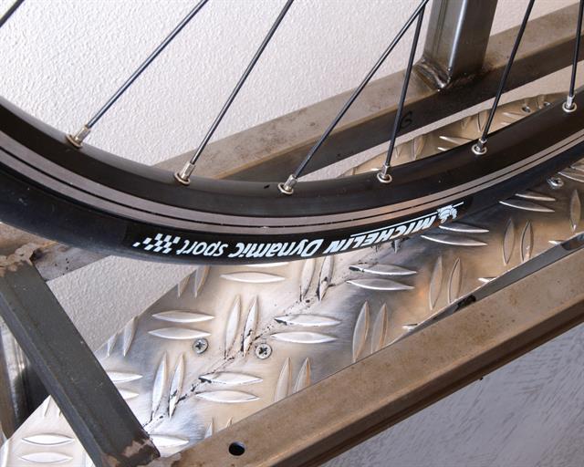 Michelin Dynamic Sport road bike tire on a rolling resistance test machine