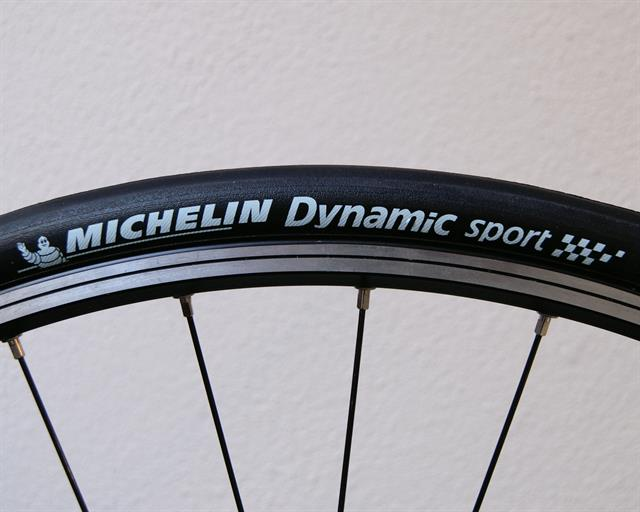 Michelin Dynamic Sport road bike tire on a rolling resistance test machine