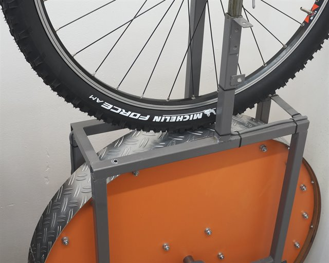 Michelin Force AM mountain bike tire on a rolling resistance test machine