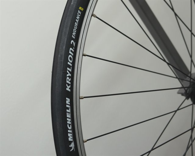 Michelin Krylion 2 Endurance road bike tire on a rolling resistance test machine