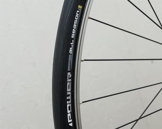 Michelin Power All Season road bike tire on a rolling resistance test machine