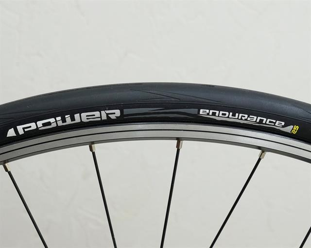 Michelin Power Endurance road bike tire on a rolling resistance test machine