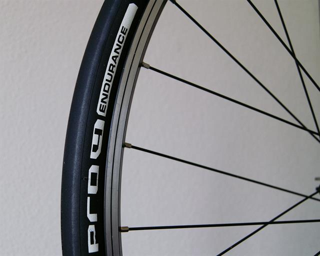 Michelin Pro 4 Endurance v2 road bike tire on a rolling resistance test machine