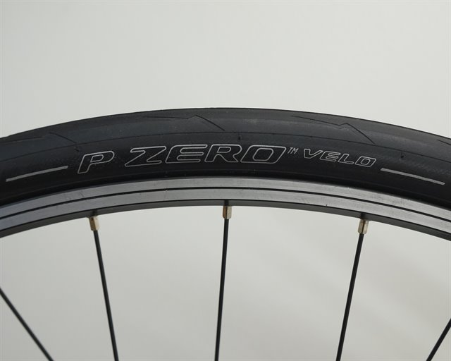 Pirelli P Zero Velo road bike tire on a rolling resistance test machine