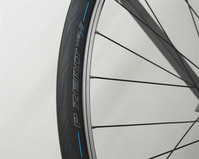 Pirelli P Zero Velo 4S road bike tire on a rolling resistance test machine
