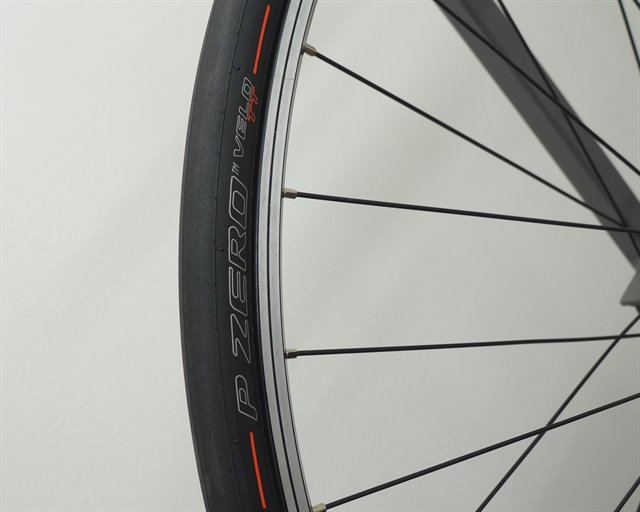 Pirelli P Zero Velo TT road bike tire on a rolling resistance test machine