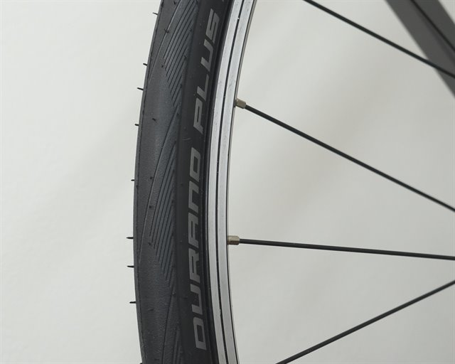 Schwalbe Durano Plus road bike tire on a rolling resistance test machine