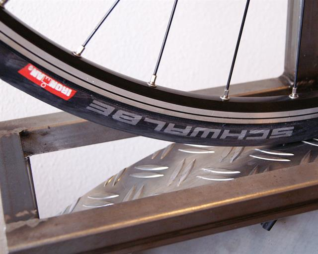 Schwalbe Ironman Tubeless road bike tire on a rolling resistance test machine