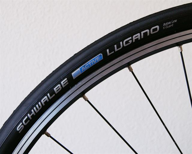 Schwalbe Lugano road bike tire on a rolling resistance test machine