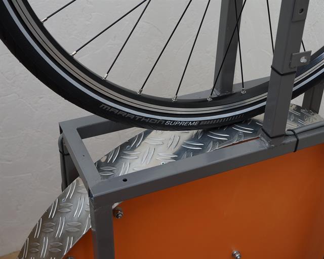 Schwalbe Marathon Supreme road bike tire on a rolling resistance test machine