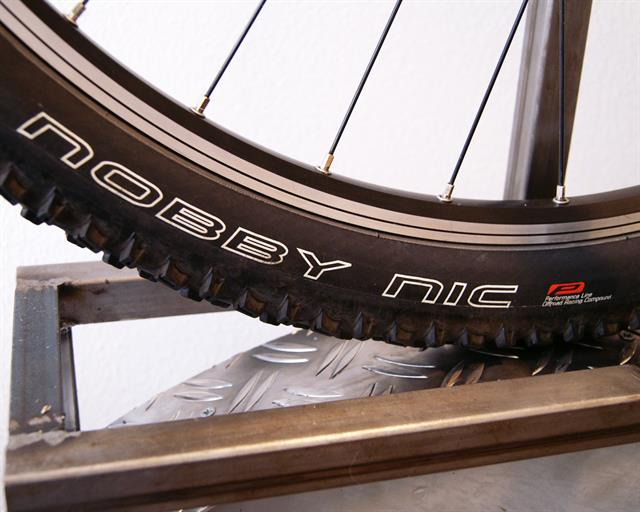 Schwalbe Nobby Nic Performance mountain bike tire on a rolling resistance test machine