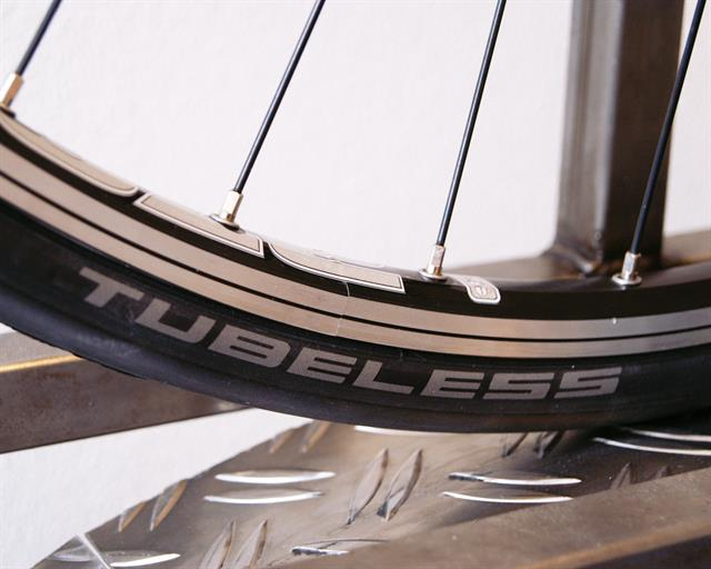 Schwalbe One Tubeless road bike tire on a rolling resistance test machine