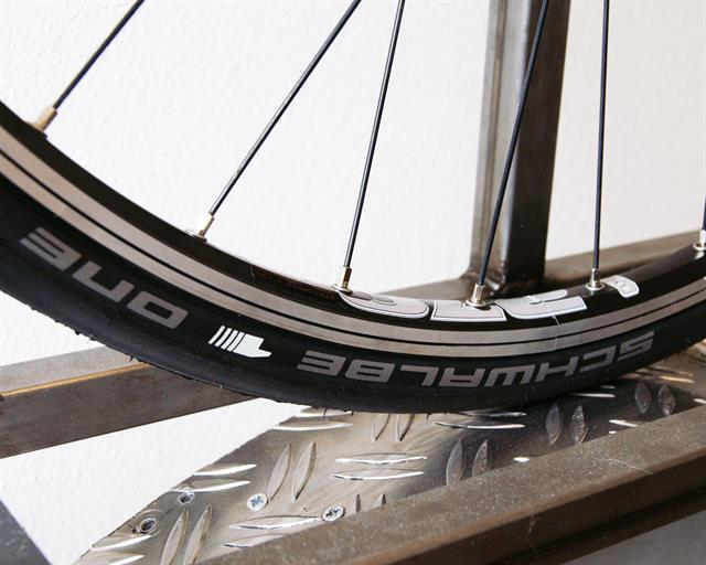 Schwalbe One V-Guard road bike tire on a rolling resistance test machine