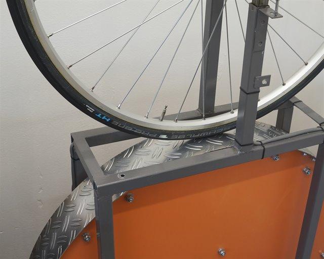 Schwalbe Pro One HT (tubular) road bike tire on a rolling resistance test machine