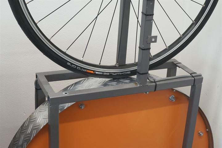 Schwalbe Pro One TLE Addix road bike tire on a rolling resistance test machine