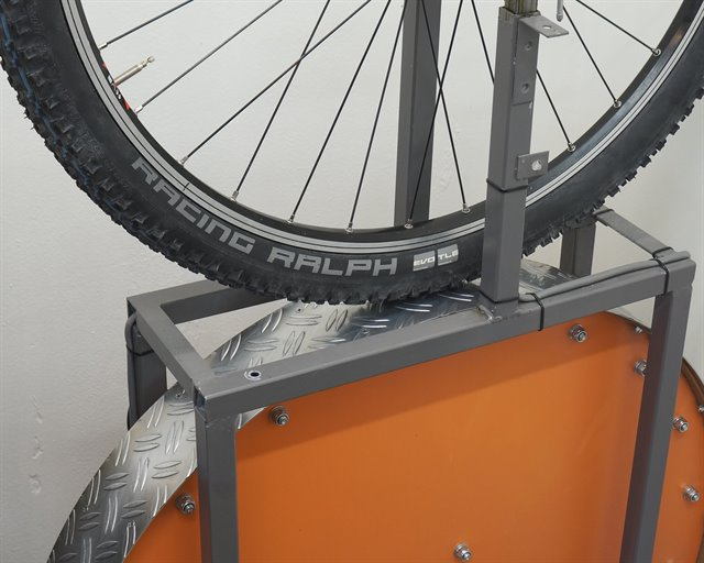 Schwalbe Racing Ralph TL-E Addix SpeedGrip mountain bike tire on a rolling resistance test machine