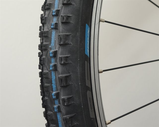 Schwalbe Racing Ralph TL-E Addix SpeedGrip  mountain bike tire on a rolling resistance test machine