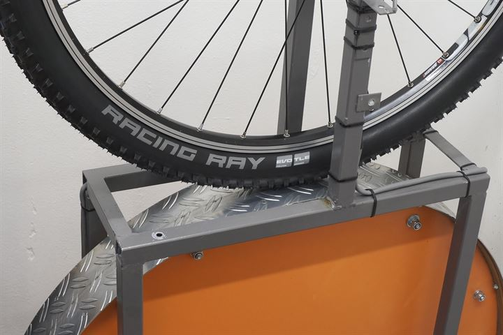 Schwalbe Racing Ray TLE Addix SpeedGrip mountain bike tire on a rolling resistance test machine