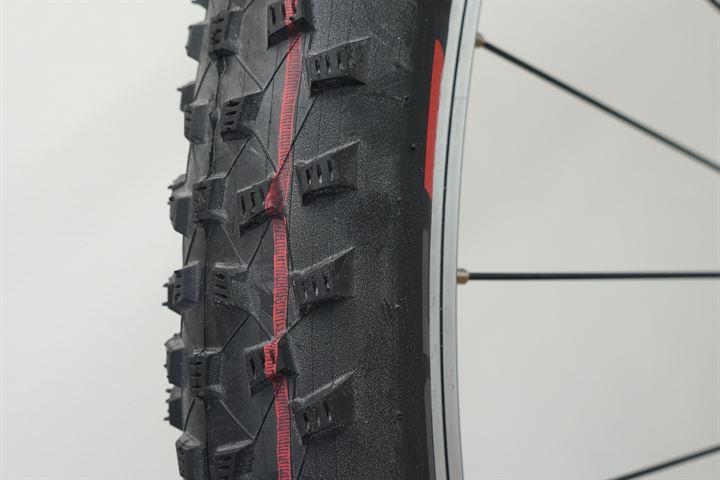 Schwalbe Rocket Ron LiteSkin Addix Speed  mountain bike tire on a rolling resistance test machine