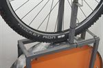 picture of a Schwalbe Rocket Ron TL-E Addix Speed on a rolling resistance test machine