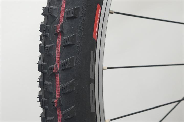 Schwalbe Rocket Ron TL-E Addix Speed  mountain bike tire on a rolling resistance test machine