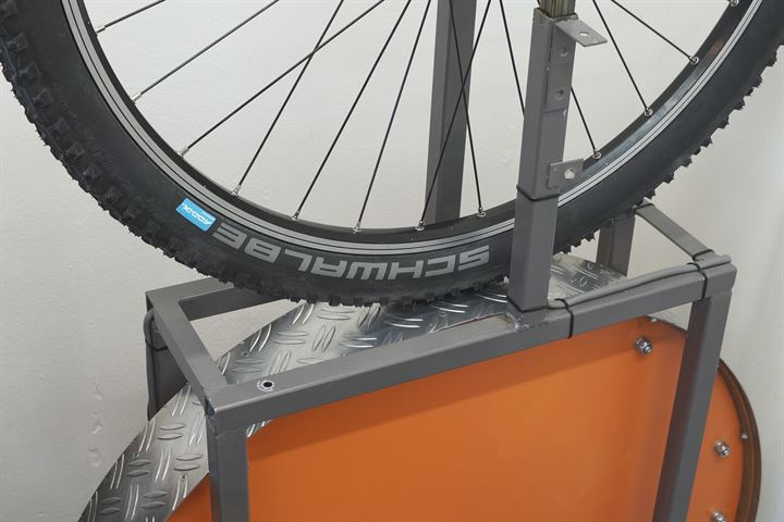 Schwalbe Rocket Ron TL-E Addix SpeedGrip mountain bike tire on a rolling resistance test machine