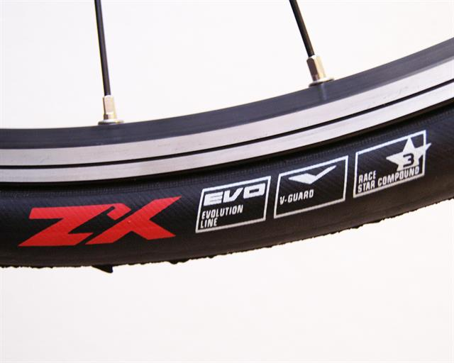 Schwalbe Ultremo ZX road bike tire on a rolling resistance test machine