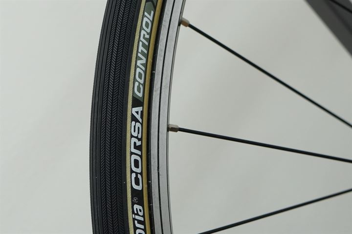 Vittoria Corsa Control G+ (open) road bike tire on a rolling resistance test machine