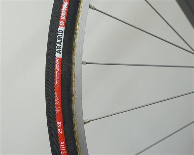 Vittoria Corsa Elite (tubular) road bike tire on a rolling resistance test machine