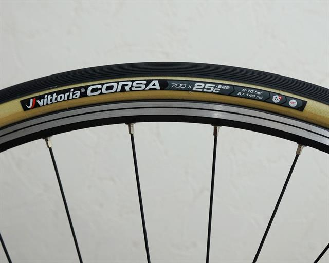 Vittoria Corsa G+ (open) road bike tire on a rolling resistance test machine