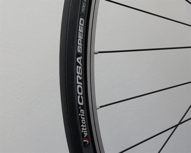 Vittoria Corsa Speed (open TLR) road bike tire on a rolling resistance test machine
