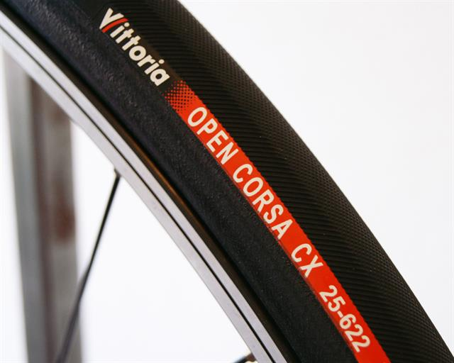 Vittoria Open Corsa CX III road bike tire on a rolling resistance test machine