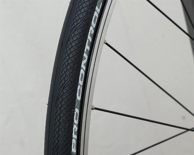 Vittoria Rubino Pro Control road bike tire on a rolling resistance test machine