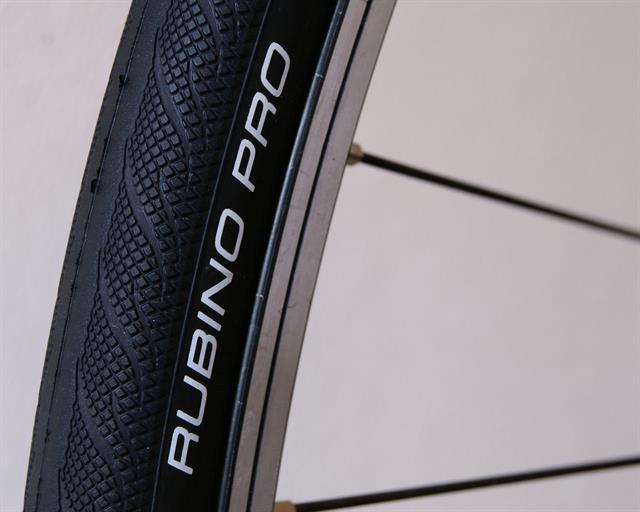 Vittoria Rubino Pro III road bike tire on a rolling resistance test machine