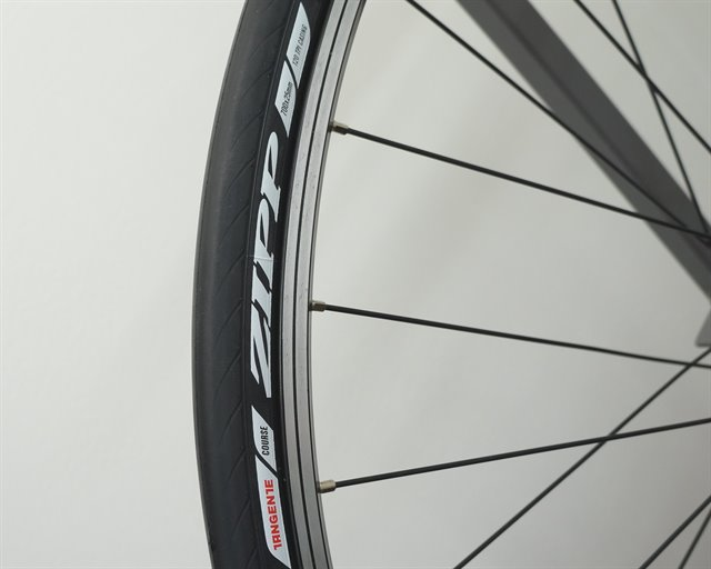 Zipp Tangente Course road bike tire on a rolling resistance test machine